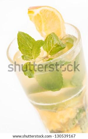 Orange Mojito cocktail close up - stock photo