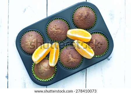 Orange muffins in baking dish. top view - stock photo