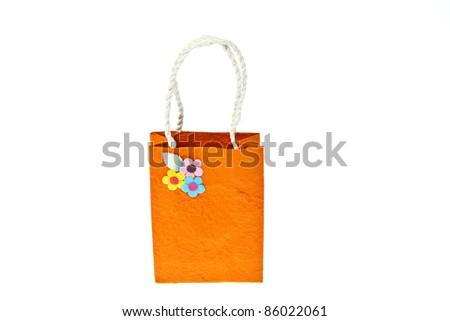 Orange mulberry paper bag isolated on white background - stock photo