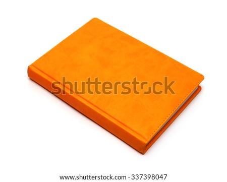 orange notebook isolated on a white background - stock photo