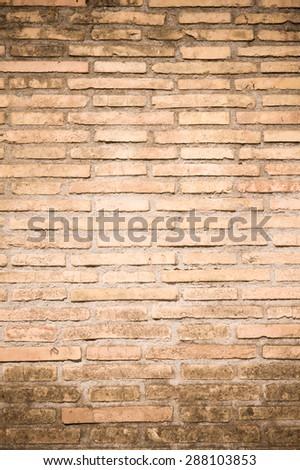 Orange old dirty bricks texture wallpaper background vertical - stock photo