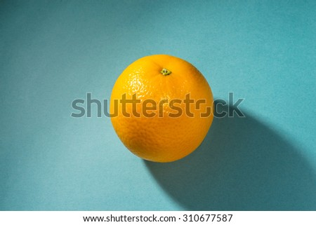 Orange on blue background - stock photo