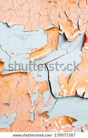 Orange paint flaking on grey metal surface texture - stock photo