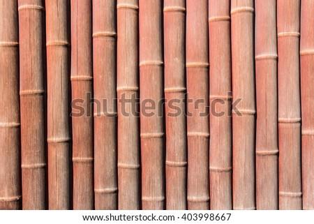 Orange painted bamboo wall background. - stock photo