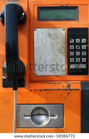 Orange payphone - stock photo