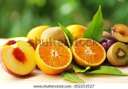 Orange, peach and kiwi sliced fruits - stock photo