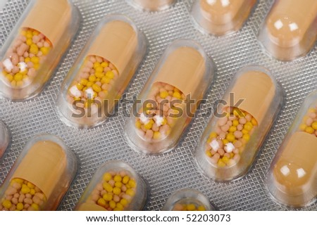 orange pills - stock photo