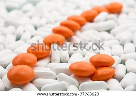orange pills close-up on medicines - stock photo