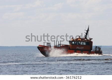 Orange pilot boat - stock photo