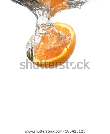 Orange plunging into cold water on a white background - stock photo