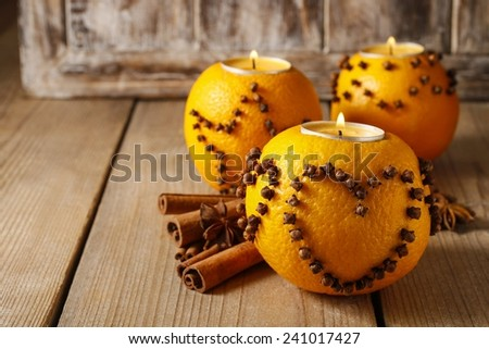Orange pomander ball with candle, christmas decoration - stock photo