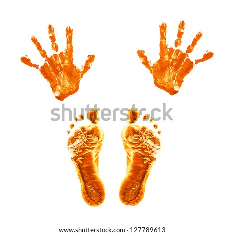 Orange prints of children's painted hands and feet. Isolated on white background. - stock photo