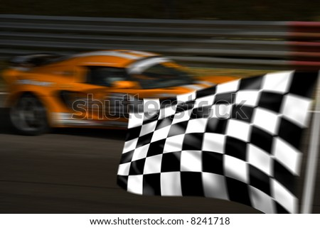 Orange racing car passing chequered flag with motion blur - stock photo
