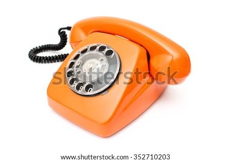 Orange retro telephone isolated on white background - stock photo