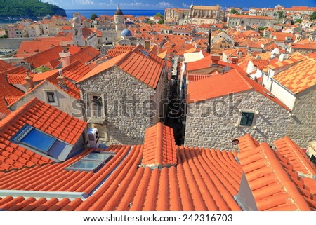 Orange roof tiles cover medieval buildings in the old town of Dubrovnik, Croatia - stock photo
