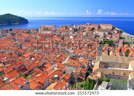 Orange roof tops of Dubrovnik old town surrounded by the Adriatic sea, Croatia - stock photo