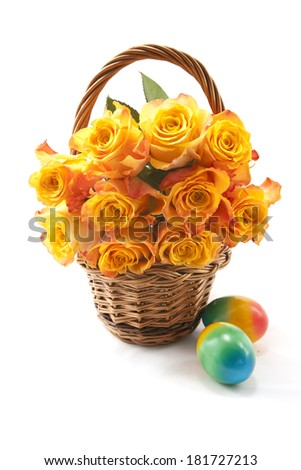 Orange roses in a wicker basket on a white background - stock photo