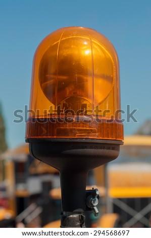 orange rotating beacon - stock photo