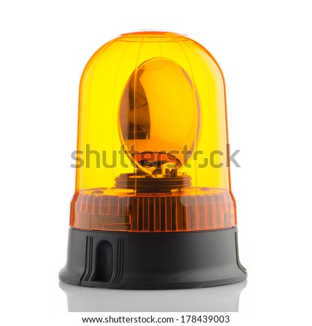Orange rotating beacon on white reflective background. - stock photo