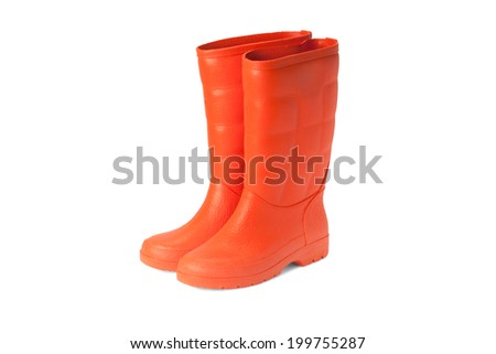 orange rubber boots on white background - stock photo