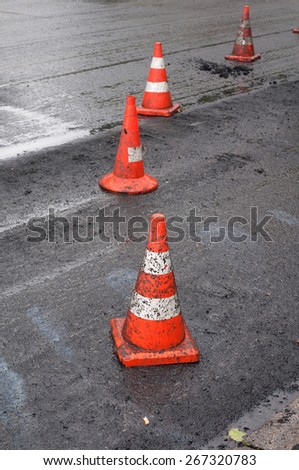 Orange safety cones are on the new asphalt - stock photo