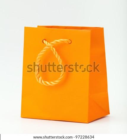 Orange shopping bag on white. - stock photo