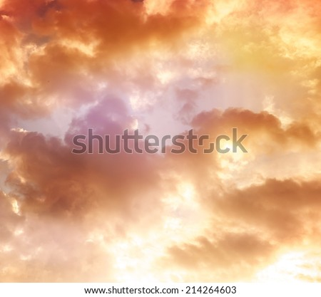 orange sky, clouds and sun behind the clouds, sun, sunrise and sunset, instagram effect - stock photo