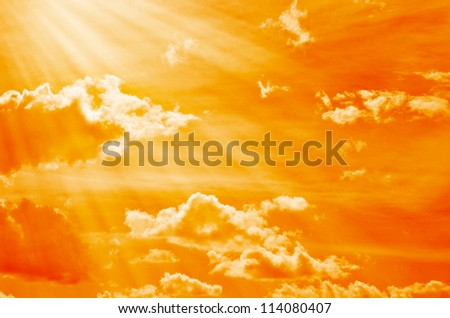 orange sky with clouds and sunlight. - stock photo