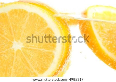 Orange slices in water on a white background - stock photo