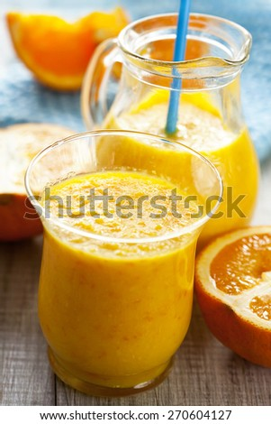 Orange smoothie -juice glass - stock photo