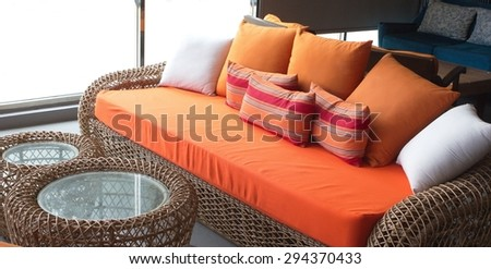 orange sofa with the colorful pillows - stock photo