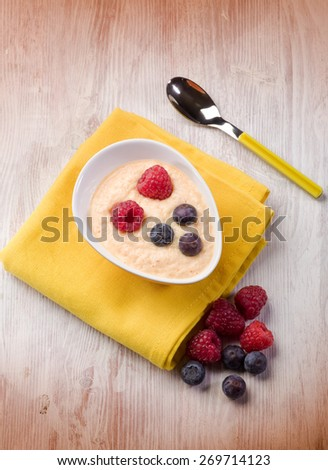 orange sorbetto with blueberry and raspberry - stock photo