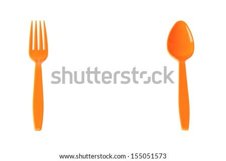 Orange spoon and fork isolated on white - stock photo
