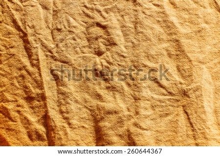 orange striped fabric as background - stock photo