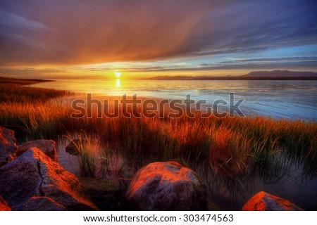 Orange sun bidding us goodbye - stock photo