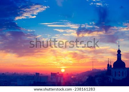 Orange sunset and cloud over cityscape Kiev, Ukraine, Europe - stock photo