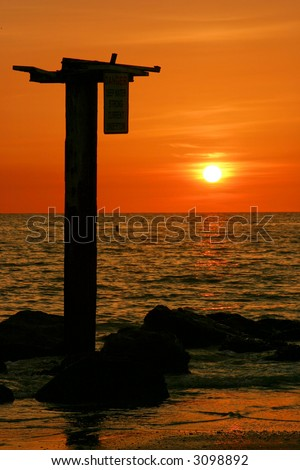 Orange Sunset in the Tampa Bay area of Florida's Gulf Coast. - stock photo