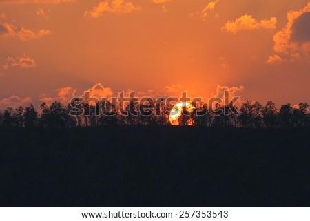 orange sunset on mountain in thailand - stock photo