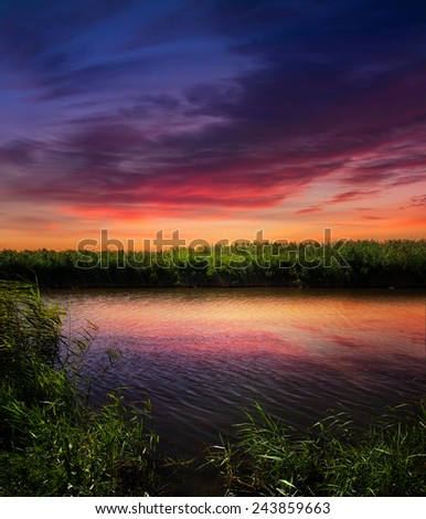 orange sunset over river - stock photo