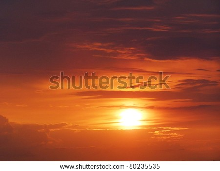 orange sunset with clouds - stock photo