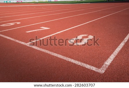 orange synthetic running track number 6 - 8  - stock photo