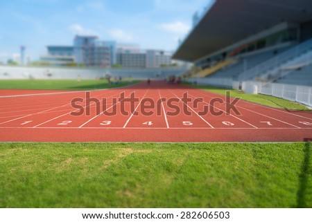orange synthetic running track number 1 - 8  - stock photo
