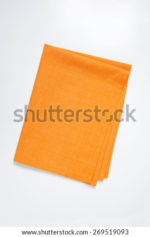 orange tablecloth on white background - stock photo