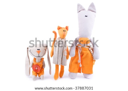 Orange team - group of toy friends isolated - stock photo