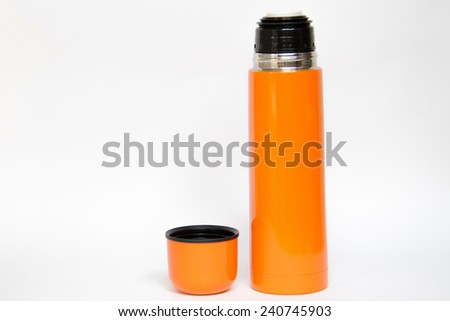 Orange thermos travel tumbler - stock photo