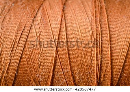 orange thread as a background - stock photo