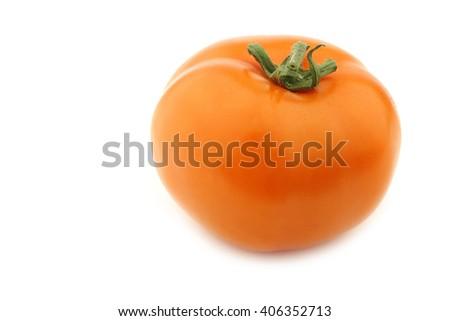 orange tomato on a white background - stock photo
