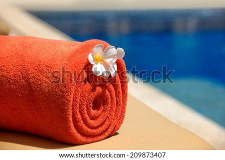 orange towels at the pool. - stock photo