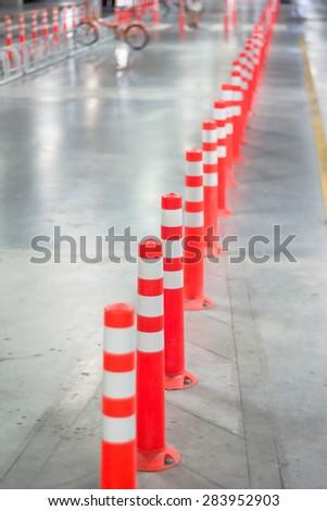 Orange traffic reflective bollards - stock photo