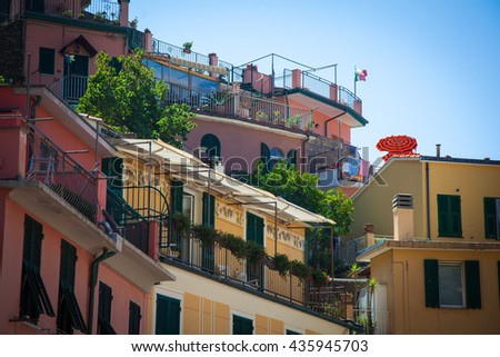 orange umbrella in Italian mediterranean village - stock photo